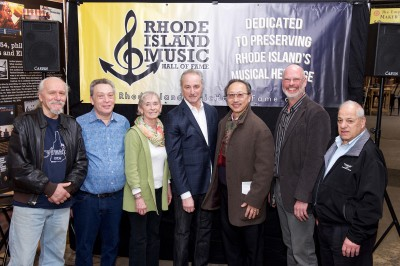 The 2018 Inductees in attendance included, from left, Tom Ghent, Andrew Polin, Susan Murphy accepting for her brother Paul Murphy, James Montgomery, John Chan, Tom Shaker accepting for Lloyd Kaplan, and Al DeAndrade from the Providence Federation of Musicians accepting for Mike Renzi.