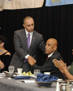 NAACP President Jim Vincent (seated, right, next to Providence Mayor Jorge Elorza) is under fire.